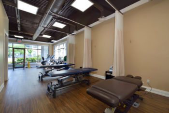 A room with physiotherapy treatment beds and exercise equipment