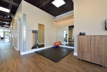 Room with exercise bands, foam mats and an exercise ball for physiotherapy exercises