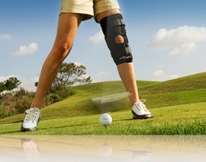 A person playing golf wearing a custom knee brace